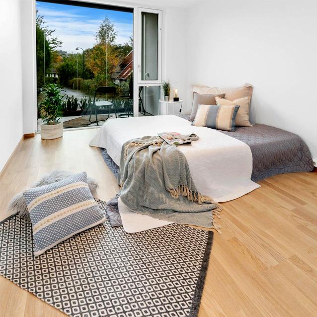 Soverommet er et rom hvor boligstyling betyr mye.  Masse puter og tekstiler og en pent oppred seng innbyr til ro og hvile.